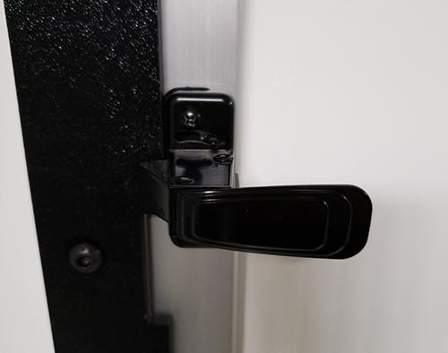 door handle of the Bio Room In-Corridor Anteroom or Abatement Door